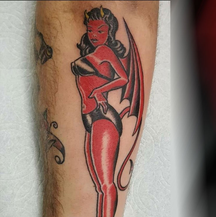 Red devil girl tattoo