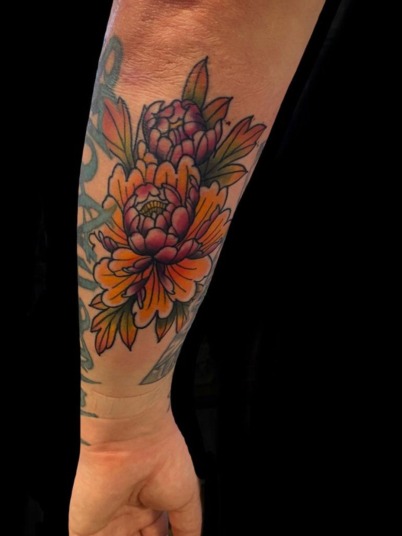 Hawaiian Flower tattoo artist