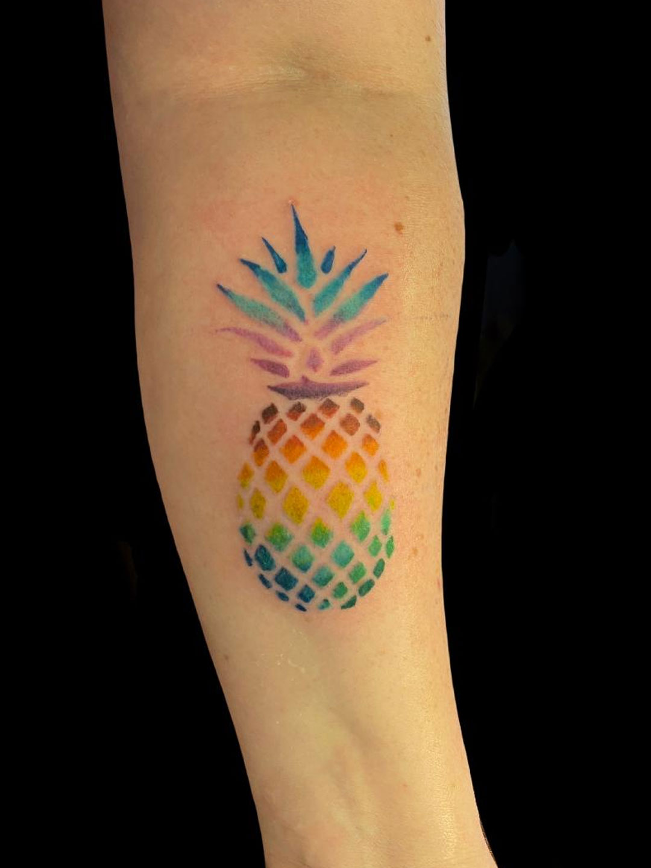 Multi color pineapple tattoo